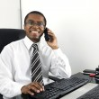Happy businessman working at desk smiling — Stock Photo