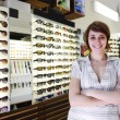 Small business: proud owner of a sunglasses store — Stock Photo #10956393