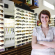 Small business: proud owner of a sunglasses store — Stock Photo
