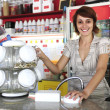 Small business:  waitress selling candy — Stock Photo
