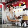 Small business: female owner or waitress — Stok fotoğraf