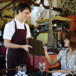 Waiter giving menu to costumer at the restaurant — Foto Stock