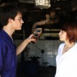 Car mechanic talking to costumer — Stock Photo #10956520