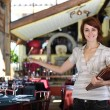 Small business: proud female owner of a restaurant — Stock Photo #10956557