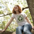 Volunteer with recycling t-shirt in the forest - Stockfoto