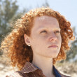 Portrait of a woman with red hair at the beach — Stock Photo