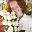 Woman buying flowers in a flower store — Stock Photo #10957703