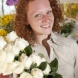 Woman buying flowers in a flower store — Stock Photo