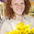 Woman holding a bunch of yellow flowers — Stock Photo #10957738