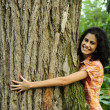 In love with nature: woman hugging a tree in the forest — Stock Photo #10958302