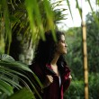 Ecotourism: female  hiker exploring wilderness of rainforest — 图库照片
