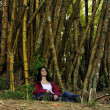 Ecotourism: female  hiker relaxing in the shadow of bamboo - Zdjęcie stockowe