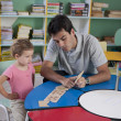 Preschool teacher and child in the classroom — Stock Photo