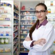 Stock Photo: Portrait of a female pharmacist at pharmacy
