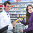 Stock Photo: Pharmacist and client at pharmacy