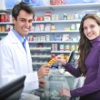 Pharmacist and client at pharmacy — Stock Photo