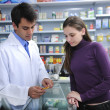 Pharmacist advising client at pharmacy — Stock Photo #10958901