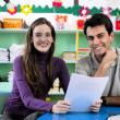 Teacher and parent in classroom - Stok fotoğraf
