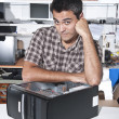 Computer problem: PC technician at workshop - Stock Photo