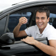 Happy hispanic man in his new car — Foto Stock