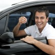 Happy hispanic man in his new car — ストック写真