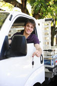 Happy owner of a new truck — Stock Photo