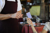 Customer paying with credit card at the restaurant — Stock Photo