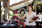 Small business: proud female owner of a restaurant — Stock Photo