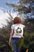 Woman with recycling bad in nature — Stock Photo