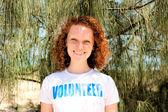 Happy volunteer girl smiling — Stock Photo
