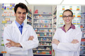 Portrait of pharmacists at pharmacy — Stock Photo