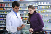 Pharmacist advising client at pharmacy — Stock Photo