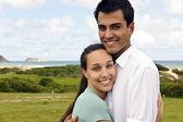 Happy hispanic couple smiling — Stock Photo