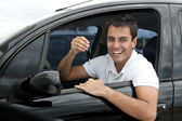 Happy hispanic man in his new car — Stock Photo