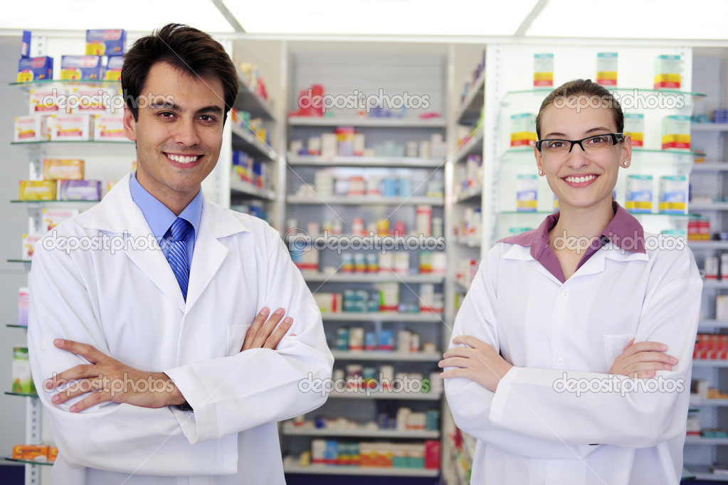 Small business owners: portrait of pharmacists at pharmacy — Stock Photo #10958851