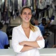 Stock Photo: Happy owner of a dry cleaning business