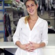 Happy owner of a dry cleaning business — Stock Photo