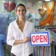 Retail business: store owner with open sign — Stock Photo
