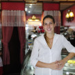 Small business: proud female owner of a cafe - Stock Photo