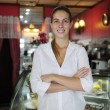 Small business: proud female owner of a cafe — Stock Photo #10960526