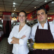 Small business: female owner of a cafe and waiter — Stock Photo