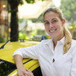 Portrait of a female taxi driver with her new cab — Stock Photo #10960777