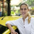 Portrait of a female taxi driver with her new cab — Stock Photo #10960807