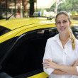 Portrait of a female taxi driver with her new cab — Stock Photo #10960816