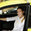 Portrait of a female taxi driver with her new cab — Stock Photo #10960822