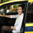 Portrait of a female taxi driver with her new cab — Stock Photo #10960828