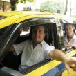 Taxi driver showing passenger a landmark — Stock Photo #10960866
