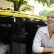 Happy female passenger inside of a taxi — Stock Photo