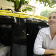 Happy female passenger inside of a taxi — Stock Photo #10960887