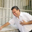 Man having a heart attack bending - Stock Photo